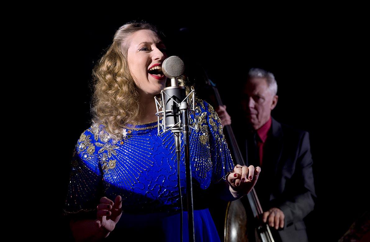 Seonaid Aitken singing in blue dress